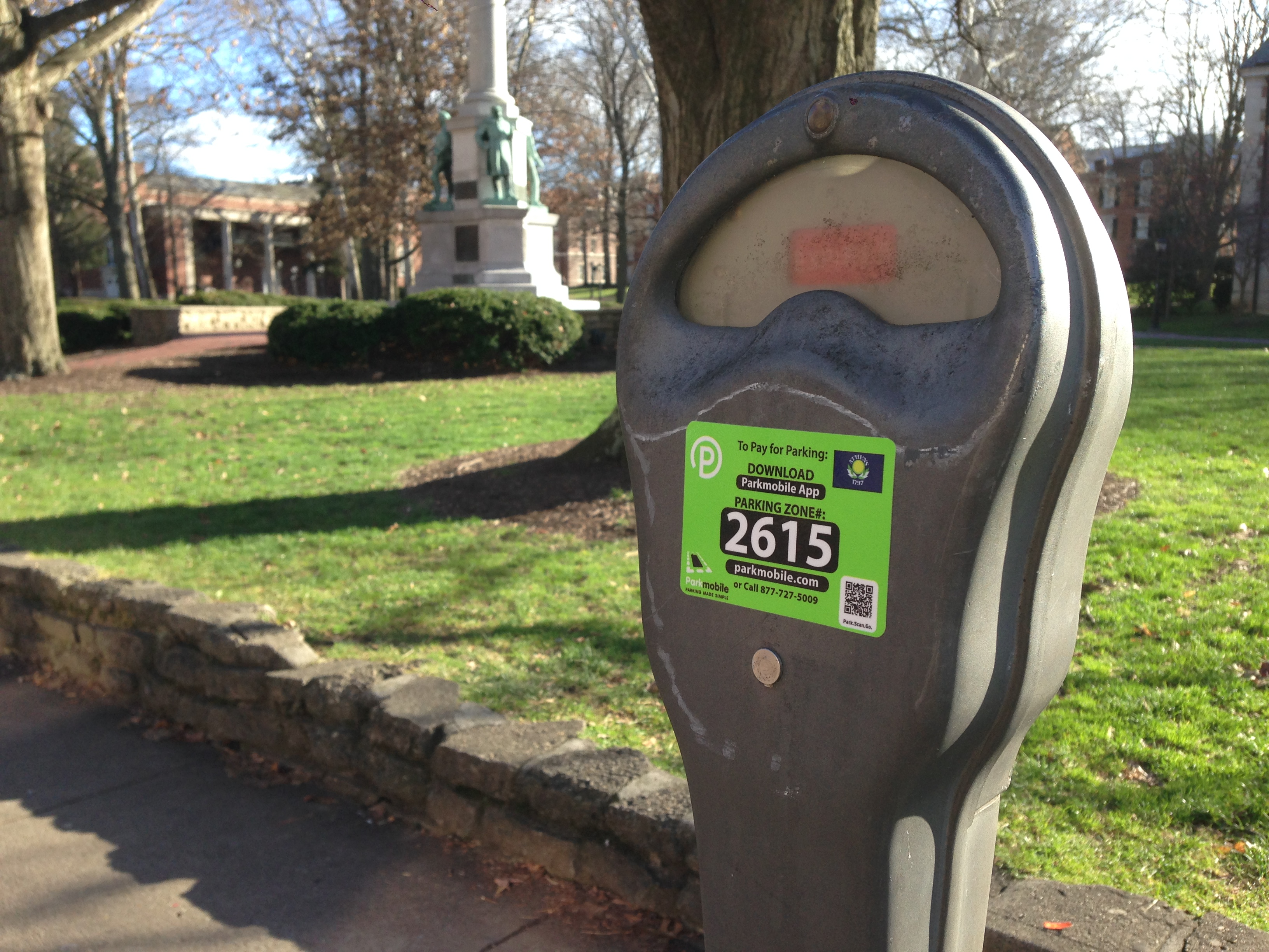 A new sticker on a City of Athens parking meter shows a new mobile way of paying.