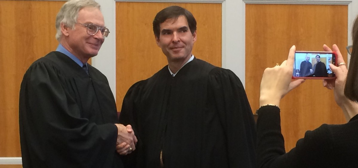 Newest Athens County Municipal Court Judge Todd Grace takes a picture with his predecessor, Judge William Grim, during his swearing-in ceremony on Wednesday.