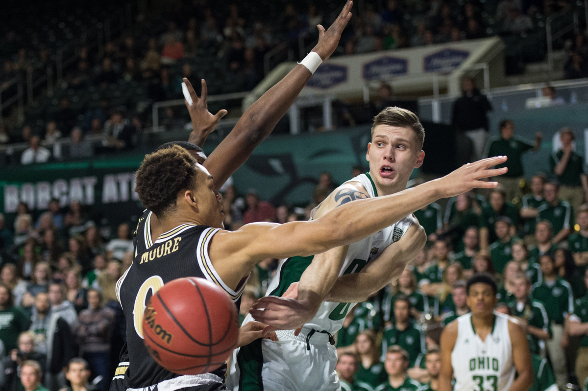 OU starting senior forward Treg Setty (#0) passes the ball behind the back of his Western Michigan defenders at the Convocation Center in Athens, Ohio on Tuesday, Jan. 19, 2016. The Bobcats defeated the Broncos 82-64.