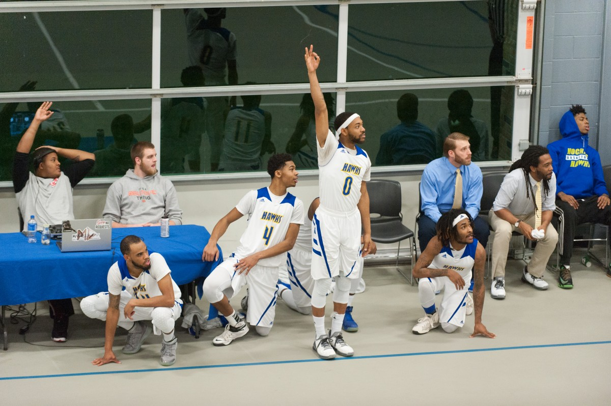 The Hocking College Men's Basketball team reacts to a three-point shot in the final minutes of their 71-62 loss at home to UC Clermont on Feb. 3. (Mark Clavin/WOUB)