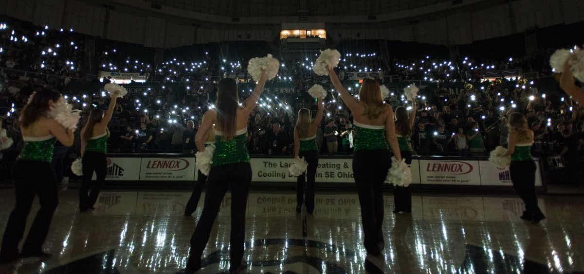 The Ohio University Dance Team pumps up the O-Zone student section in the Convocation Center during the introduction of the Bobcat starters against Northern Illinois University on Saturday. (Nicole Raucheisen/WOUB)