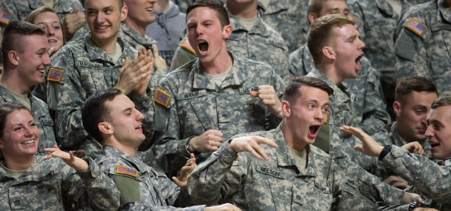 OU Army ROTC member Dillion Wyant celebrates with his comrades after the Bobcats basketball team scored against Northern Illinois University on Saturday. (Nicole Raucheisen/WOUB)