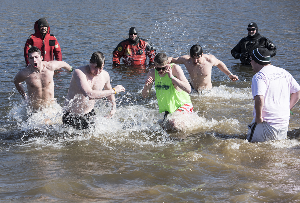 Members of Ohio University's Alpha Omega chapter of Lambda Chi Alpha take the Polar Bear Plunge at Lake Snowden in Athens County Ohio on February 13, 2016. The fraternity would raise over $600.00. (Robert McGraw/WOUB)