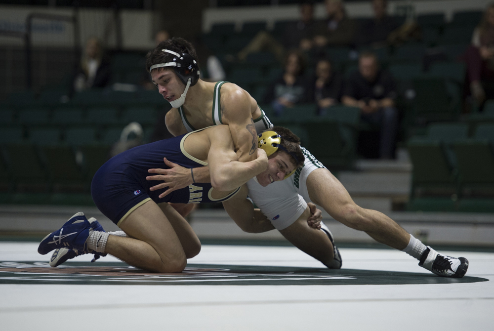 Ohio University Noah Forrider vs Clarion's Michael Bartolo in the 141 pound wrestling match on January 16, 2016. (Robert McGraw/WOUB)