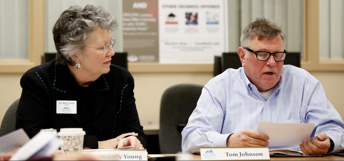 """Hocking College President Dr. Betty Young listens to Board of Trustees Chairman Tom Johnson Tuesday night. The Hocking College Education Association issued a vote of """"no confidence"""" in Young and Dr. Myriah Davis.  Photo by Jasmine Beaubien for WOUB News"""