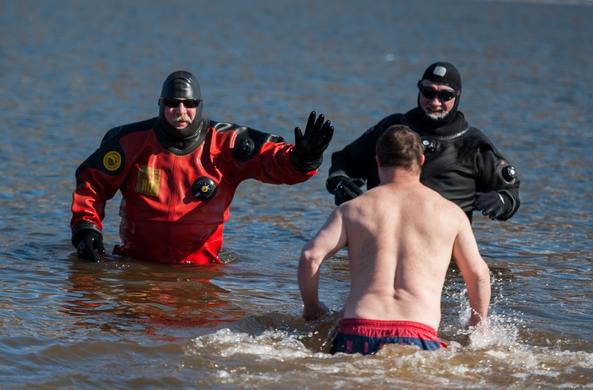 Mark Snyder runs to the rescue team for a high-five and a hug during the Polar Plunge. Snyder has participated in this event for the past three years. The Polar Plunge was held at Lake Snowden on February 13, 2016. (Michael Swensen/WOUB)