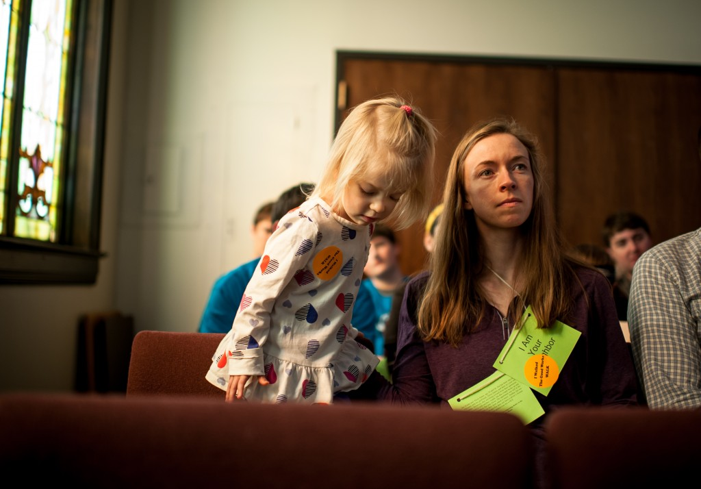 Ruth Owen (left) and Joni Owen (right) listen to Keith Wasserman during the 14th Annual Good Work Walk at the Central Avenue Church Westside Location on February 20, 2016. (MICHAEL SWENSEN FOR WOUB)