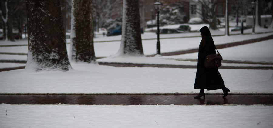 """Hannah Borowski, a sophomore majoring in political science and global studies: war and peace, walks through College Green on her way to work on February 9, 2016. """"I had two classes cancelled today, it was great,"""" said Borowski. (Michael Swensen for WOUB)"""