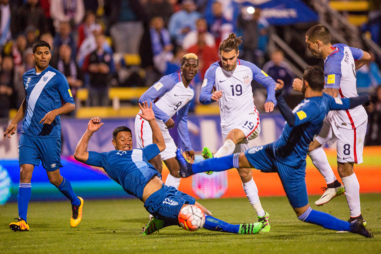 COLUMBUS, OHIO — U.S. Men's National Team midfielder, Graham Zusi (19), strikes the ball through oncoming defenders of the Guatemala Men's National Team to score his team's 3 goal in the 46th minute of the World Cup qualifying match at MAPFRE Stadium in Columbus, Ohio on Mar. 29, 2016. 20,624 people attended the game to watch the U.S. defeat Guatemala 4-0.