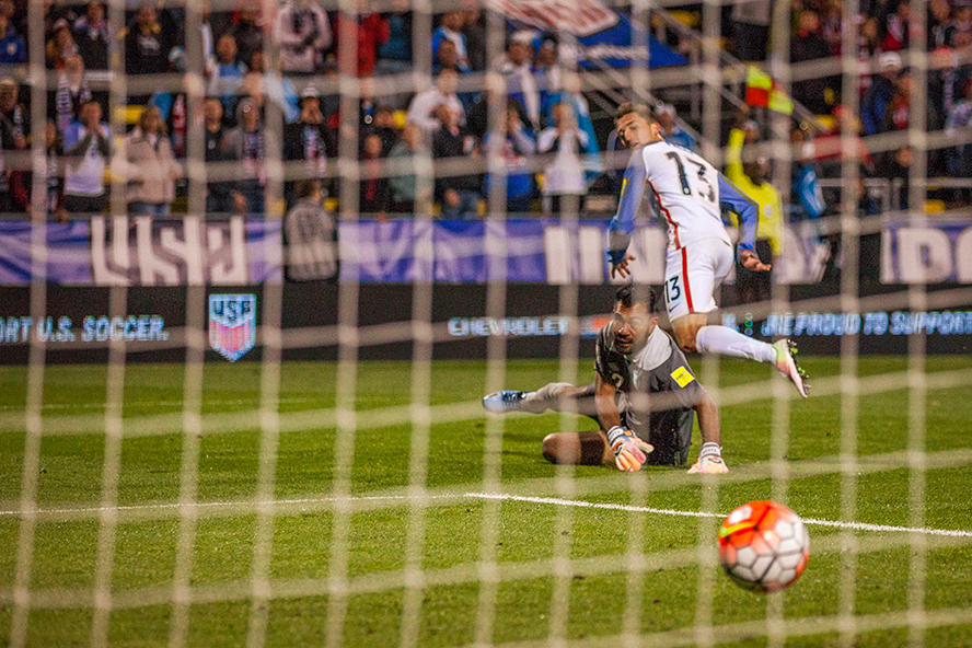 COLUMBUS, OHIO — U.S. Men's National Team midfielder, Ethan Finlay, puts the ball past Guatemala Men's National Team goalkeeper, Paulo Motta, during the World Cup qualifying match at MAPFRE Stadium in Columbus, Ohio on Mar. 29, 2016. Despite Finlay's effort, no goal was scored on account of his offside position prior to the shot.