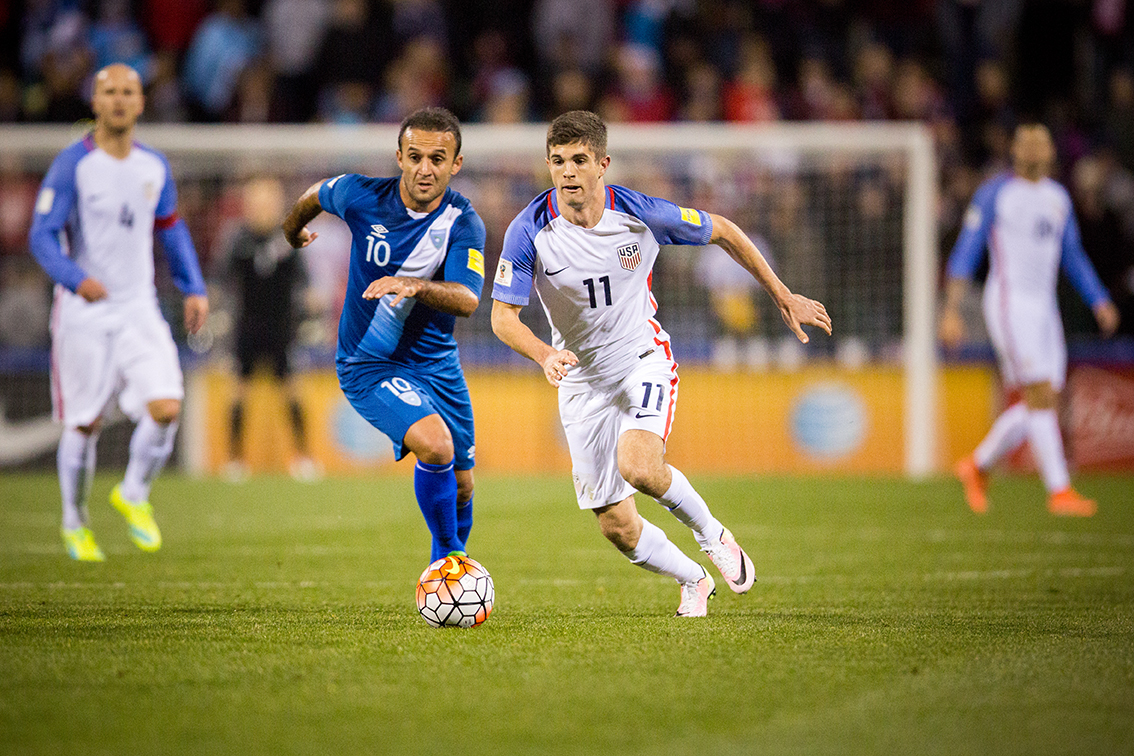 COLUMBUS, OHIO — U.S. Men's National Team midfielder, Christian Pulisic (11), outruns Guatemala Men's National Team forward, Jose Contreras for the ball during the World Cup Qualifying match at MAPFRE Stadium in Columbus, Ohio on Mar. 29, 2016. 17-year-old, Pulisic, became the youngest American ever to appear in a World Cup qualifier when he made his national team debut in the second half of the U.S. 4-0 win over Guatemala.