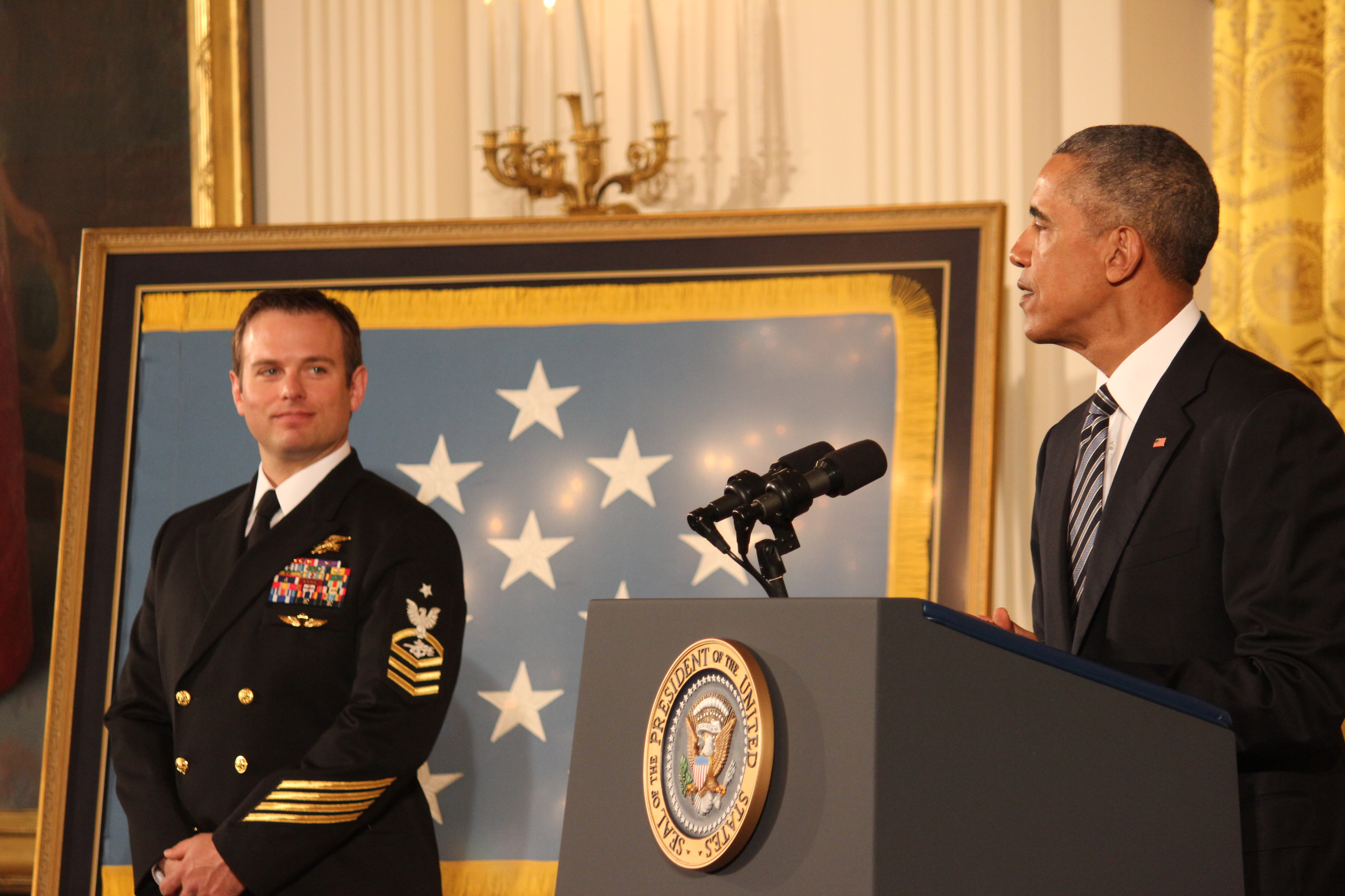 "President Obama says Monday that Medal of Honor recipient Senior Chief Ed Byers is ""defined by a deep sense of humility."" Two other Medal of Honor recipients and many of Byers' relatives attended the ceremony in the White House East Room. SHFWire photo by Luke Torrance"