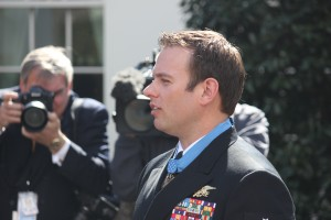 Medal of Honor recipient Ed Byers thanks his family and his comarades for their support during a meeting with the media outside the White House after Monday's ceremony. SHFWire photo by Luke Torrance