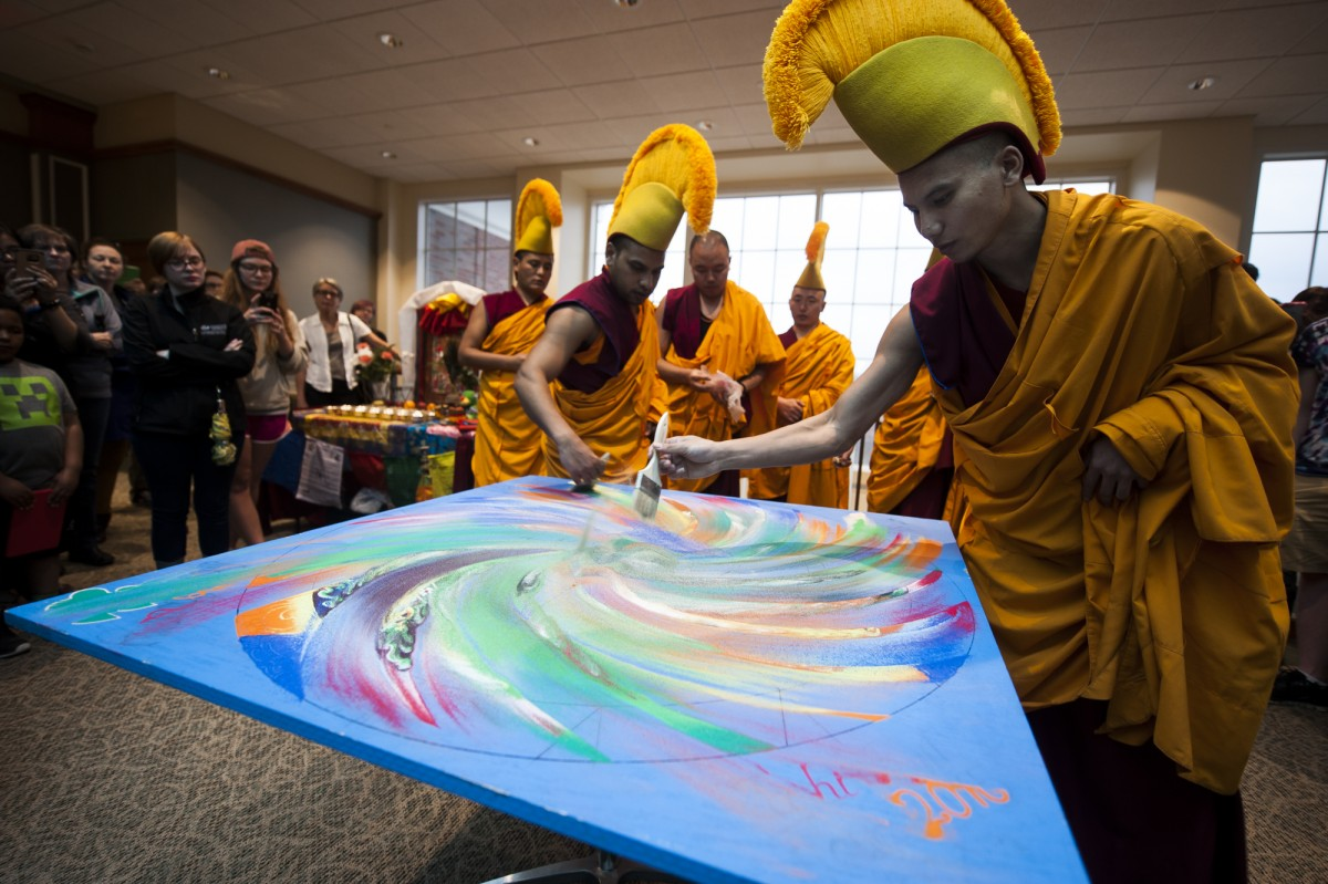 Athens, Ohio- Tibetan monks destroy the mandala that they created as a part of the ceremony to show that nothing is eternal. This took place on the fourth floor of Baker Center at Ohio University on March 10, 2016. (MICHAEL SWENSEN FOR WOUB)