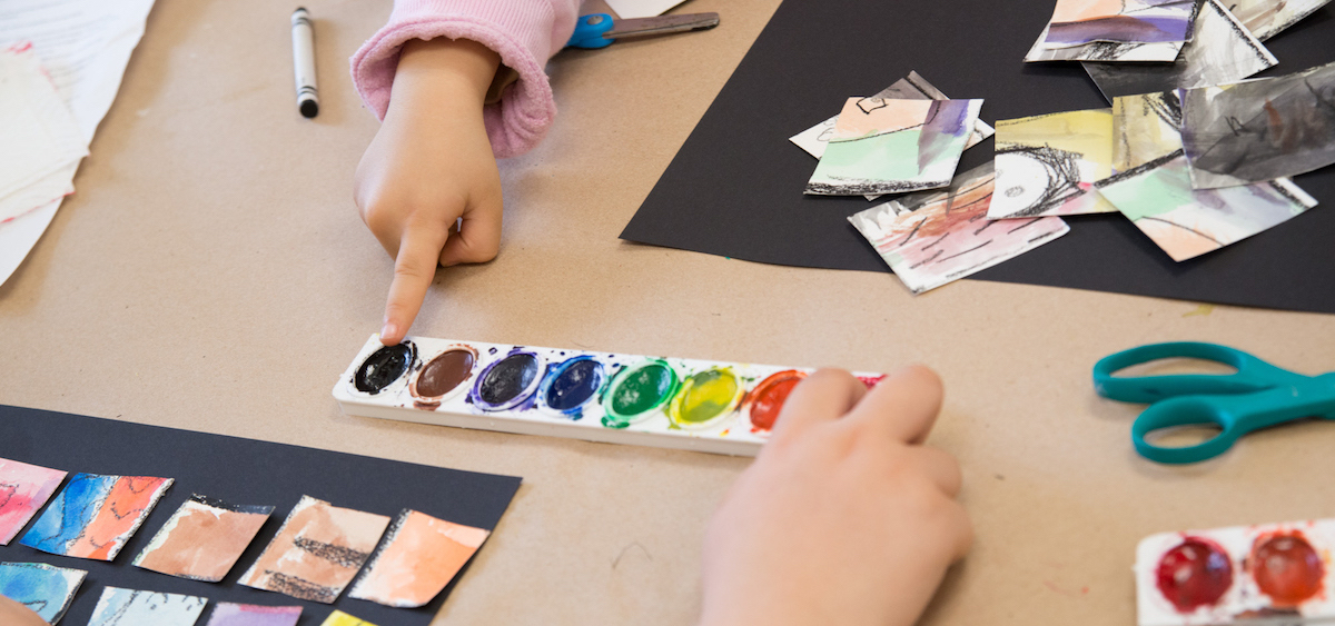 Area children finger paint at a recent Family Art Encounters workshop at the Kennedy Museum of Art. (Robert McGraw/WOUB)