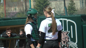 Madison Claytor (left) and Savannah Jo Dorsey (right) talk between pitches