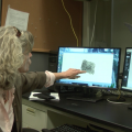 Dr. Molly Morris compares two fingerprints