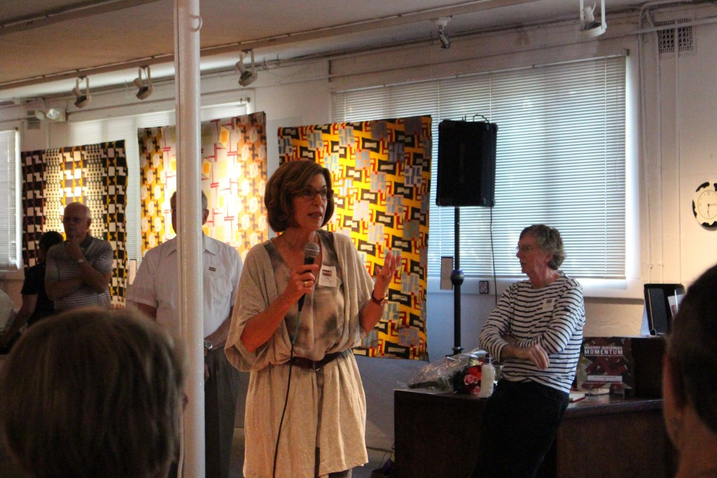"""Lynn Last Rotstein, the president of the 2016 Dairy Barn Arts Center Board of Trustees, addresses the crowd gathered for the public reception of """"Mastery: Sustaining Momentum"""" May 27, 2016. (WOUB/Joe Votaw)"""