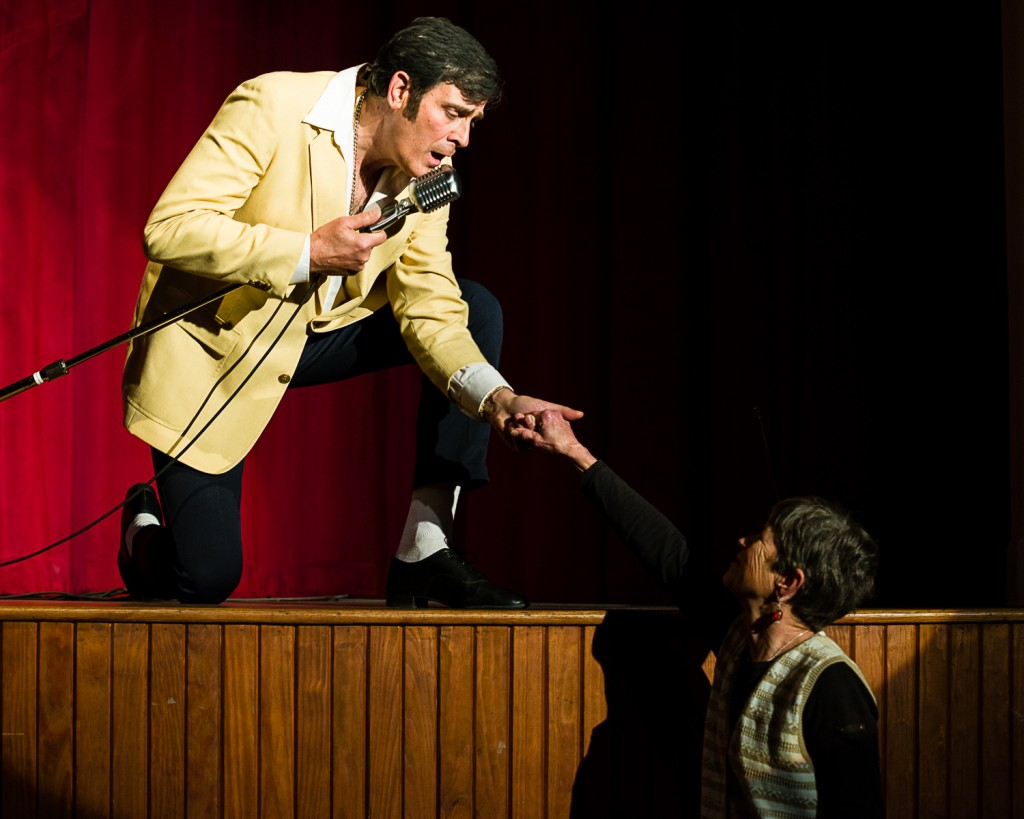 """Alex """" Elvis"""" Couladis sings """"Take my hand—take my whole life, too"""" to director Celeste Parsons. (Morristowne Photography)"""