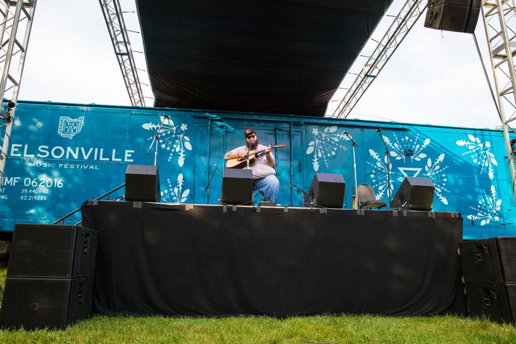 John Morland performs on the brand new Boxcar stage, Friday at Nelsonville Music Fest. (WOUB/Jasmine Beaubien)