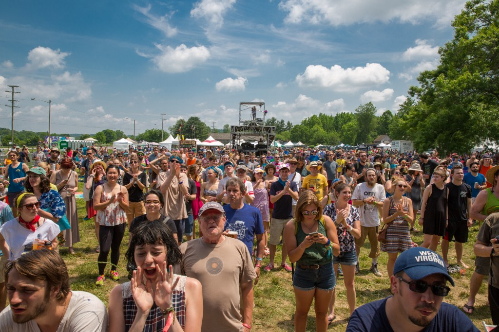 Fans wait for Mojoflo to perform on the Main Stage, Friday at the Nelsonville Music Fest. (WOUB/ Jasmine Beaubien)