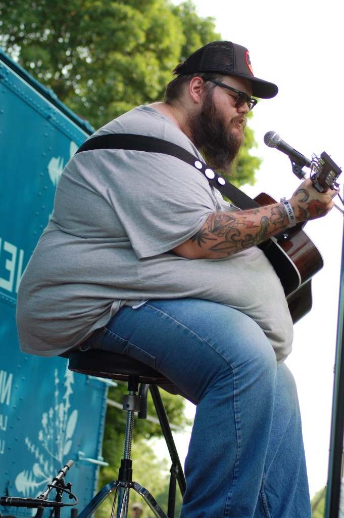Tulsa, Oklahoma singer-songwriter John Moreland during his Boxcar Stage set Friday afternoon. (WOUB/Shelby Coulter)
