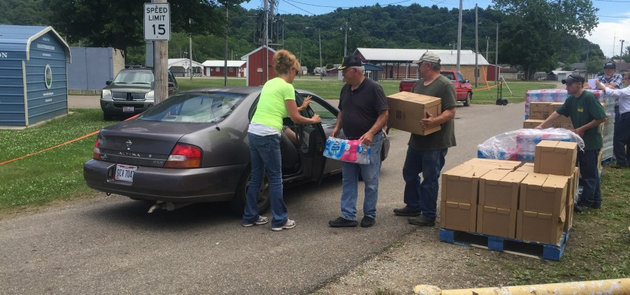 Donated water put into one of the vehicles waiting Monday at the Hocking County Fairground