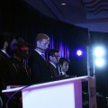 Photo: Prof. Don Flournoy, Competition Chair, stands with team Pathway to Power on stage at ISDC Puerto Rico