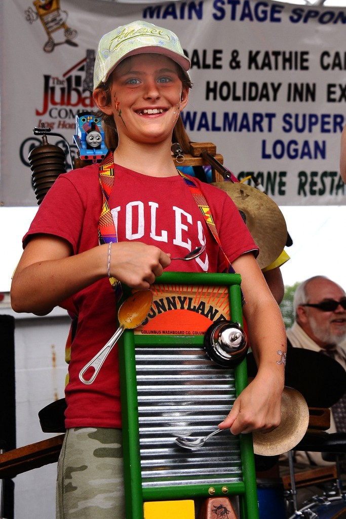 A young washboard player enjoys the festivities in Downtown Historic Logan. (Photo courtesy of festival organizers)