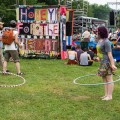 A couple of festival goers practice their hula-hooping during the thick of the 2016 Nelsonville Music Festival. (WOUB/Jasmine Beaubien)