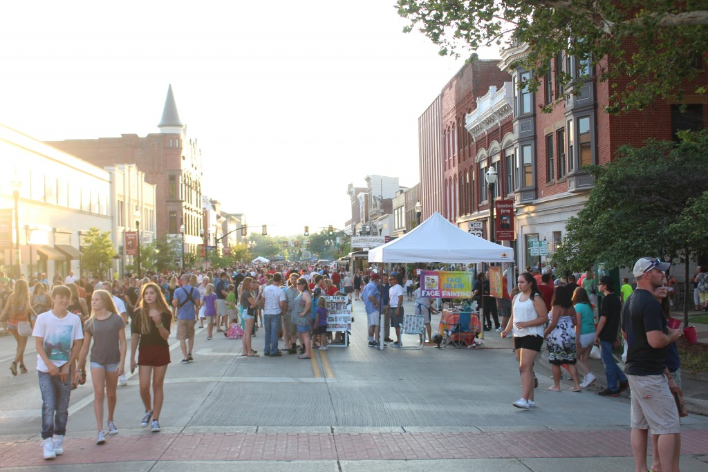 The streets of downtown Lancaster swelled Friday night with lots of enthusiastic folks eager to take in the 2016 Artwalk. (WOUB/Emily Votaw)