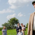 "Glenna Brucken as Rose, left to right, Ellie Clark as Agnes, Sarah Harlett as Maggie, Katherine Scholl as Kate, Johnathan Putnam as Father Jack, Joe Carlson as Gerry Evans, Kat Bramley as Christina, with Brian David Evans as Michael Evans in the foreground in the Tantrum Theater production of ""Dancing at Lughnasa"" (Daniel King)"