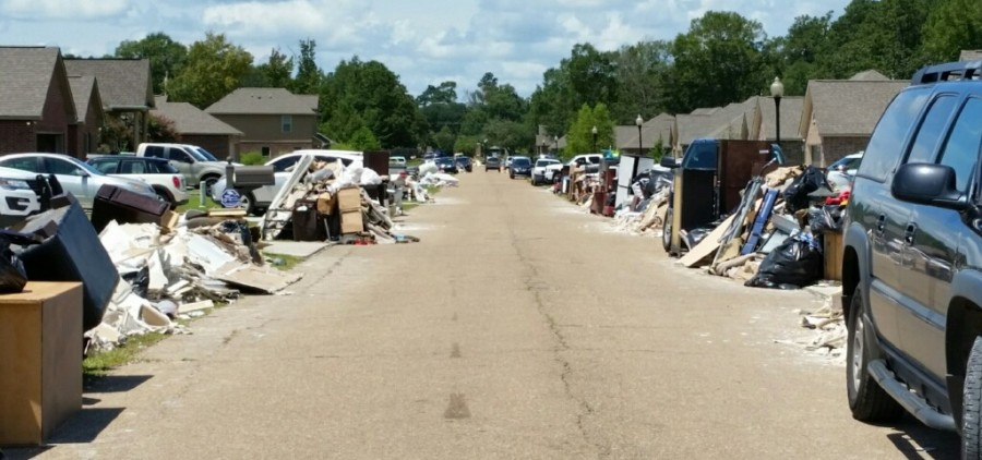 A street in Hammond, Louisiana, is lined with items damaged by record floods in the area. Photo courtesy of Dean McNeal