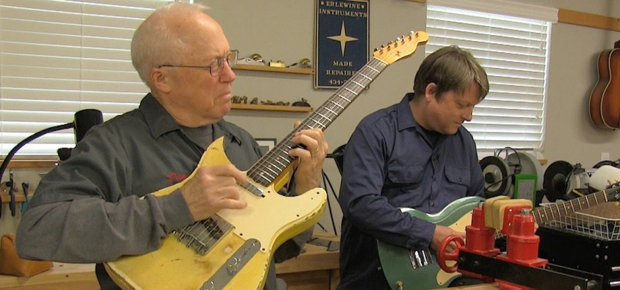 Dan Erlewine rocks out in his home guitar repair studio during the making of one of the many videos that he creates for his long-time employer, Stewart-MacDonald. Also pictured is local luthier and musician Erick Coleman. (youtube.com)