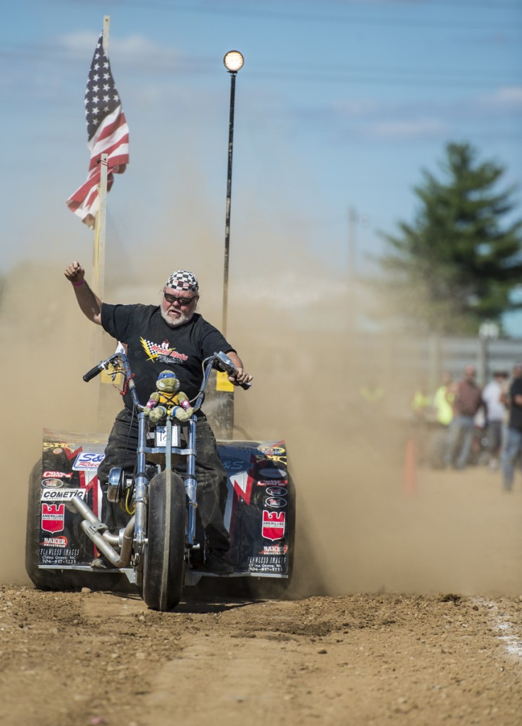 Danno Simmons from Kannapolis, N.C., attempts to qualify for one of the rodeo events by pulling a weighted wagon down the track at the 2016 Easyriders Rodeo Tour in Chillicothe, Ohio.