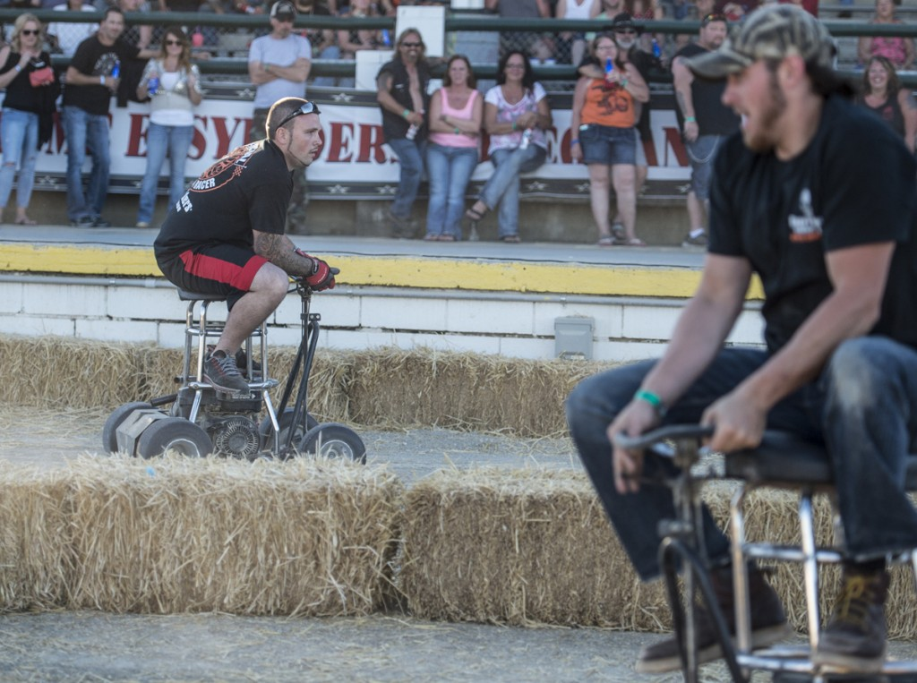 Adam Hadley (left) from Marietta, Ohio, wins the Saturday bar stool race at the 2016 Easyriders Rodeo Tour in Chillicothe, Ohio.