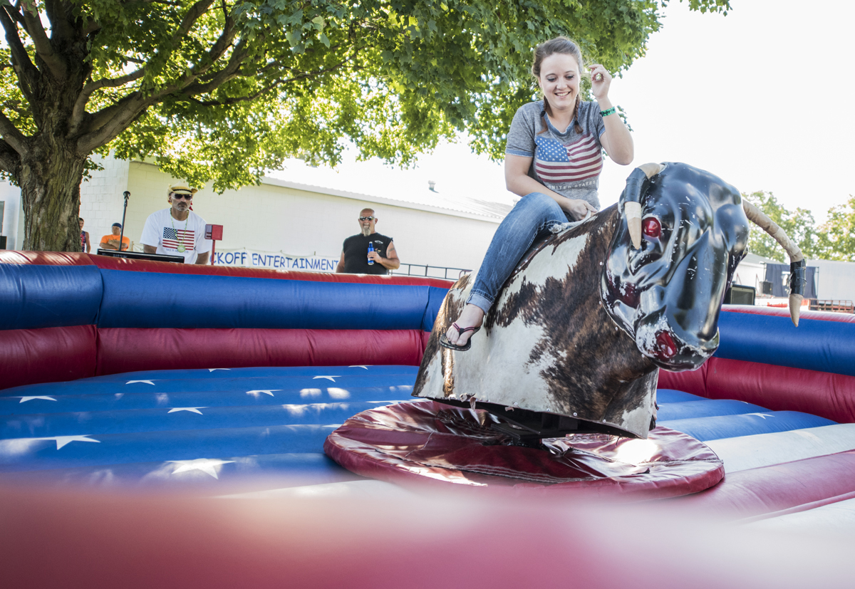 Kayleana Zornes from Grove City proves to her male friends that she can ride the bucking bull ride just as good as they can at the 2016 Easyriders Rodeo Tour in Chillicothe, Ohio.