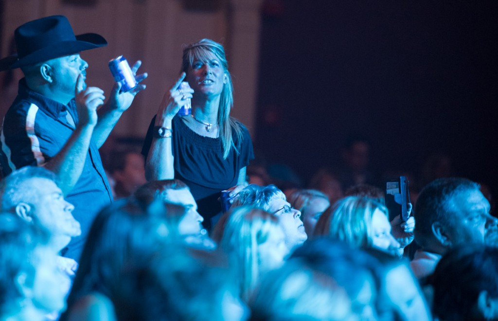Fans take pictures and dance during the Scotty McCreery concert at the Templeton-Blackburn Alumni Memorial Auditorium in Athens, Ohio, on September 08, 2016.