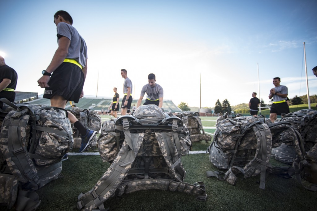 Members of the Army ROTC put on their back packs before they run in the 9/11 challenge at Peden Stadium where they will run over 2000 steps to simulate the steps of one of the Twin Towers that fell on September 11, 2001. (Robert McGraw/WOUB)