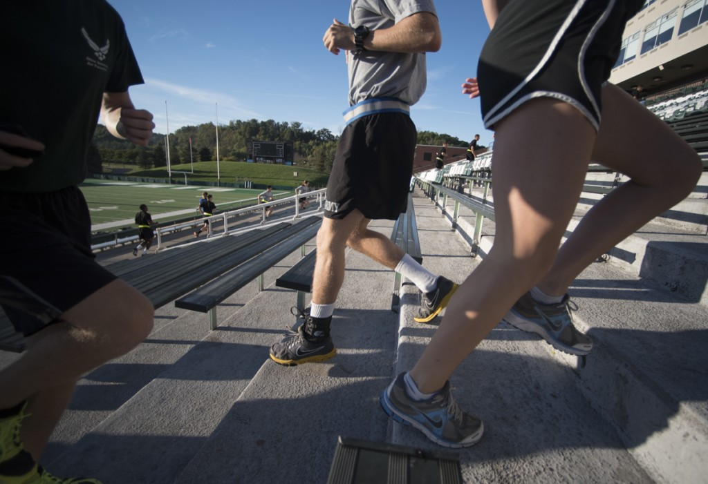 Participants run the steps of Peden Stadium to honor those affected by the tragic events of September 11, 2001. (Robert McGraw/WOUB)