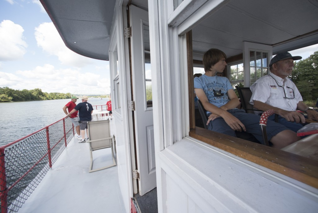 Joey Binkrey watches Captain Heckert as he pilots the ships down the Ohio River. (Robert McGraw/WOUB)