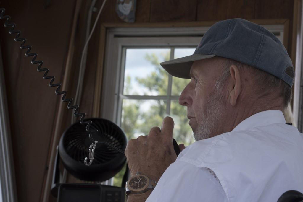 Captain Heckert announces the start of the sternwheel race to his passengers during the 2016 Marietta, Ohio Sternwheel Festival. (Robert McGraw/WOUB)