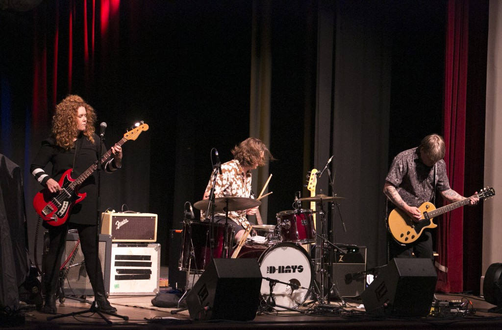Local surf rock band The D-Rays opend for Southern Culture on the Skids Friday night at Stuart's Opera House in Nelsonville. The band is Missy Pence on bass, Maceo Gabbard on drums Erick Coleman on lead guitar. (WOUB/Jennifer Coombes)