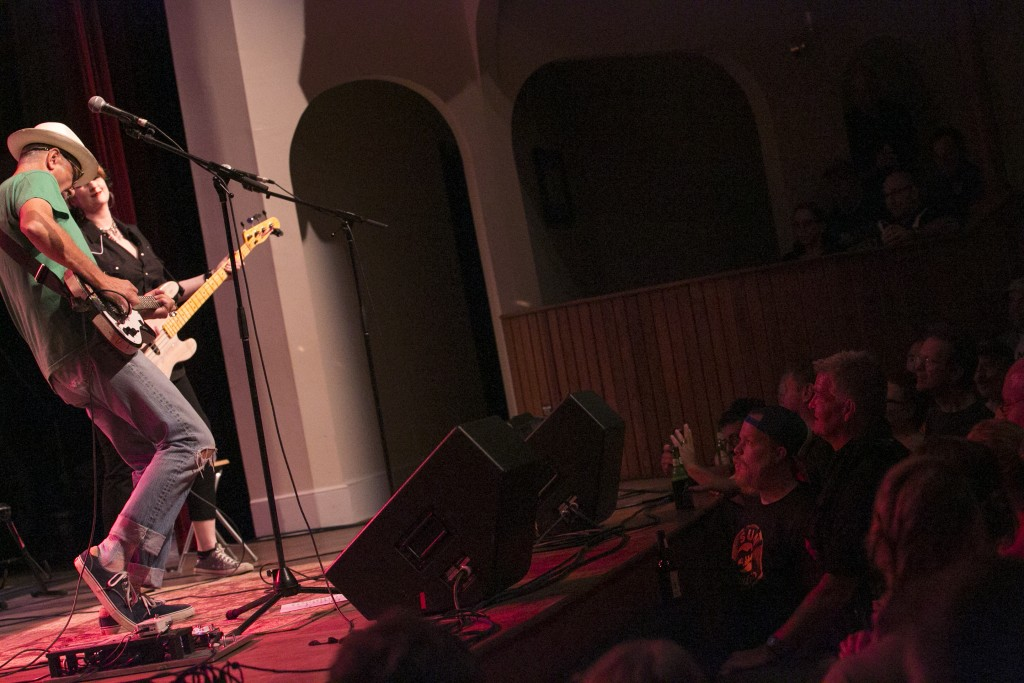 Guitarist Rick Miller of Southern Culture on the Skids performs a riff of the band's rockabilly surf music to a packed audience at Stuart's Opera House in Nelsonville Friday night. (WOUB/Jennifer Coombes)