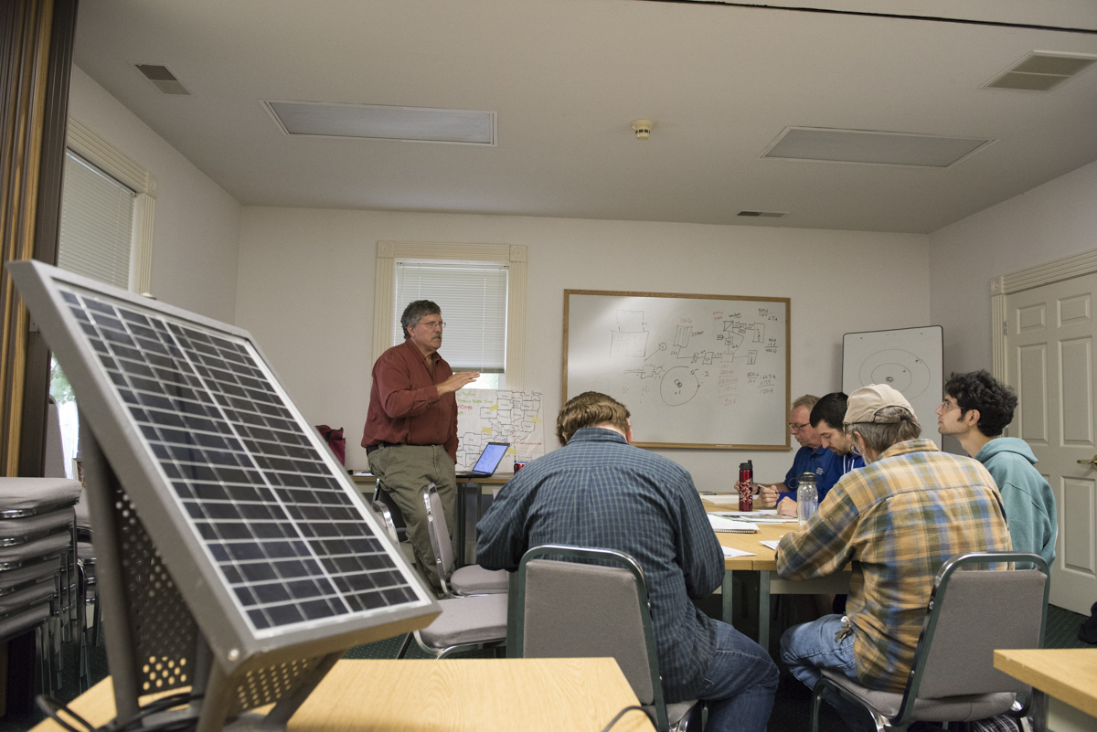 Jay Warmke, left, from Blue Rock Station, explains to the workshop participants the importance of solar energy  on September 28, 2016, in Athens, Ohio. (Robert McGraw/WOUB)