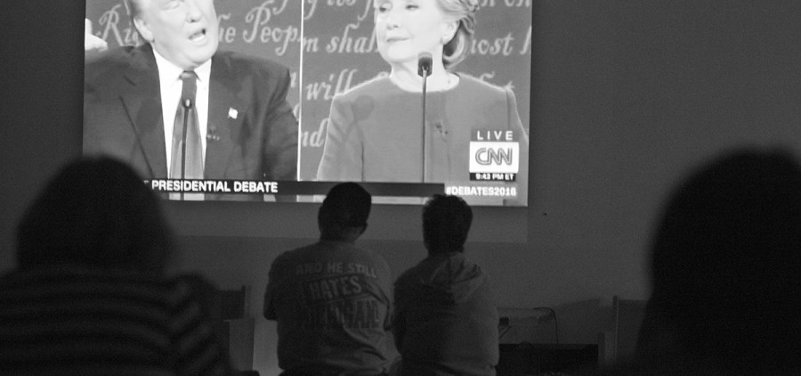 Hilary Clinton supporters watch the first presidential debate between Clinton and Trump on Monday, Sept., 26, 2016 at 1154 E Canal Street in Nelsonville, Ohio. (Kelsey Brunner/WOUB)