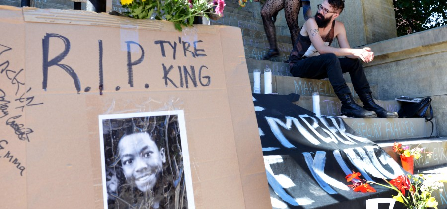 Mary Baxter, left, and Jack Opal join the memorial of Tyre King on the Athens County Municipal Courthouse steps on Wednesday, September 21, 2016 in Athens, Ohio. The African American 13-year-old, Tyre King, was shot and killed by police officers earlier this month in Columbus, Ohio. (Kelsey Brunner/WOUB)