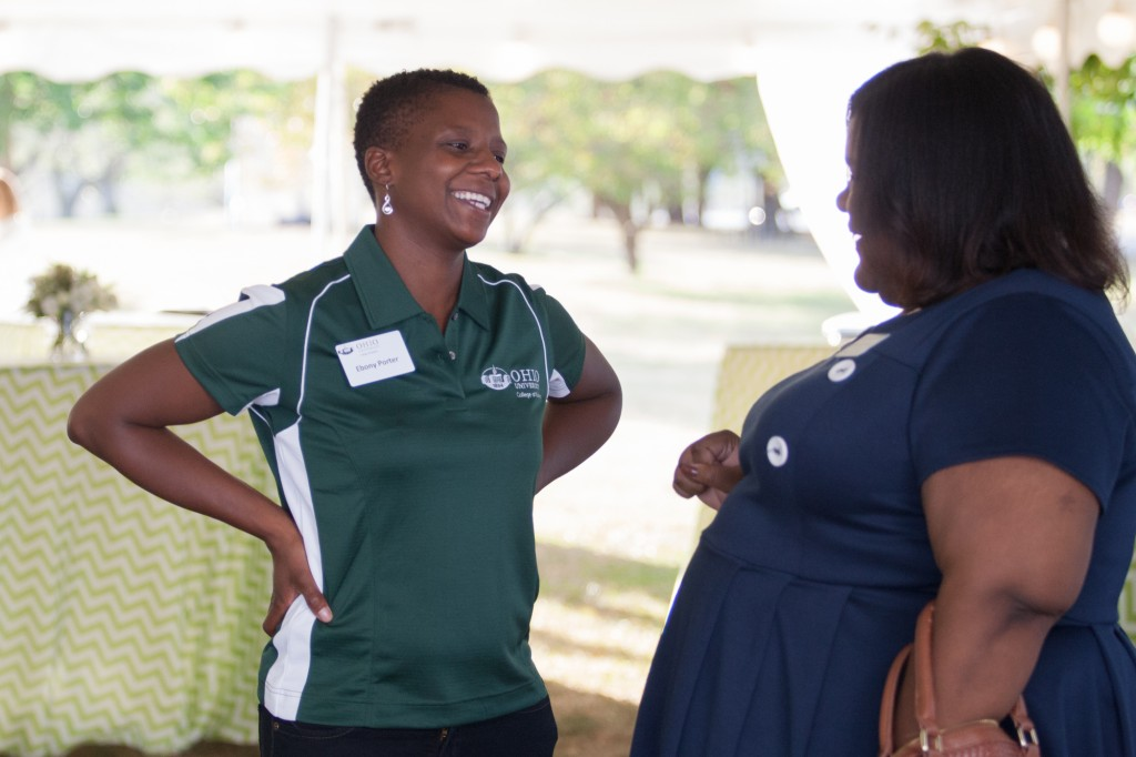 Ebony Porter (left) shares a laugh with Lynnette Henderson (right) during the Black Alumni Reunion at Ohio University on September 15, 2016.