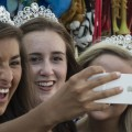 (L-R) Tori Reffitt Queen, Emily Hicks 2nd runner up, and Abbie Wright 1st runner up of the Portsmouth, Ohio River Days Festival take a selfie on Queens Day at the 2016 Wellston Coal Festival.