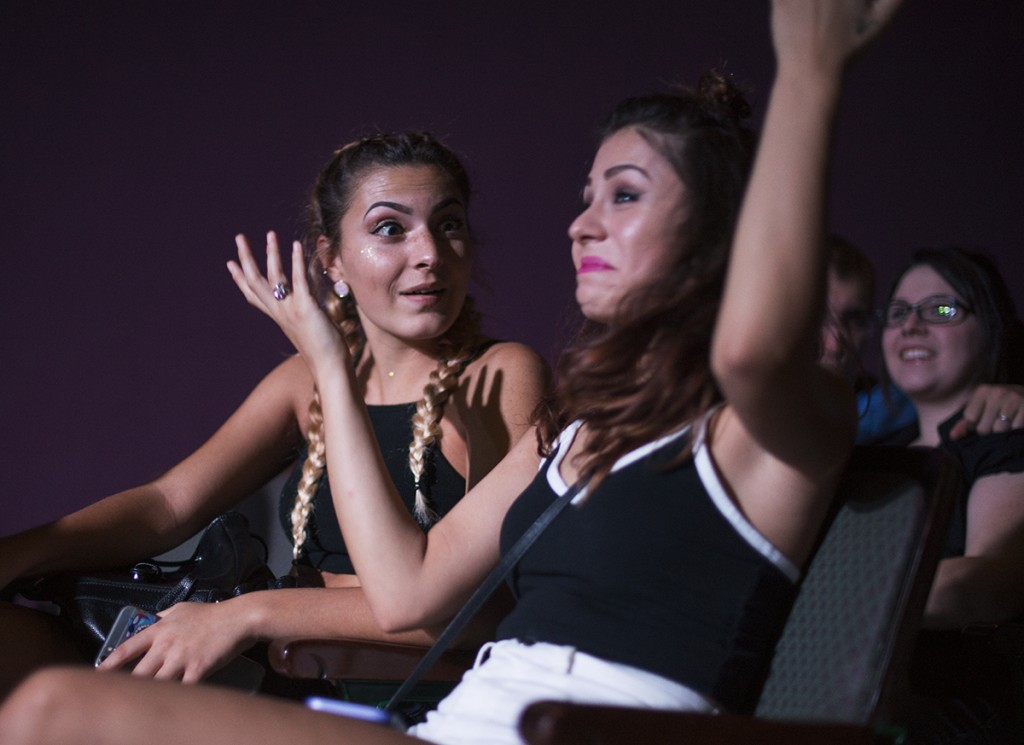 Katie Grunkemeyer, left, and Ceaira Smith, right, react to the band Public's performance at the Templeton-Blackburn Alumni Memorial Auditorium. Musical artist Daya performed after Public. (Marlene Sloss/WOUB).